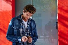 Young man using smartphone outdoor Stock Photos