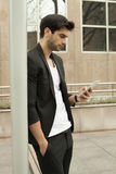 Young man using a smartphone Royalty Free Stock Photography