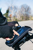 Young man using a smartphone riding a bicycle Royalty Free Stock Image