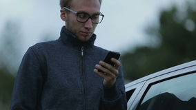 Young man using a smartphone stock video footage