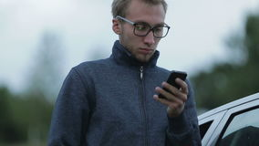 Young man using a smartphone stock footage