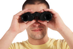 Young man using spyglass Royalty Free Stock Image