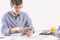 Young man using tablet Royalty Free Stock Images
