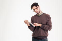 Young man using tablet computer Stock Photo
