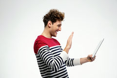 Young man using tablet computer Royalty Free Stock Images