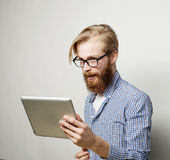 Young man  using a tablet computer Royalty Free Stock Photos