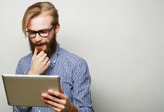 Young man  using a tablet computer Royalty Free Stock Photography