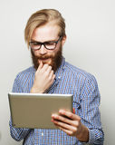 Young man  using a tablet computer Stock Image