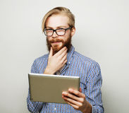 Young man  using a tablet computer Royalty Free Stock Photo