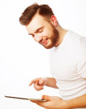 Young man  using a tablet computer Stock Photography
