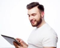 Young man  using a tablet computer Stock Photos