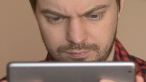 Man using tablet computer. Young man using tablet computer touchscreen in home stock footage