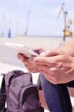 Young man using a tablet or an e-book outdoors Stock Photos