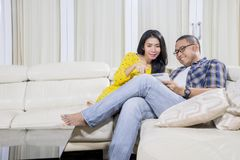 Young man using a tablet with his wife at home royalty free stock photos