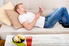 Young man using a tablet at home Stock Photography
