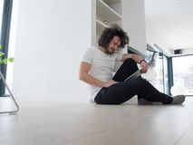 Young man using a tablet at home Royalty Free Stock Photo