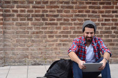 Young man using a tablet. Stock Photography