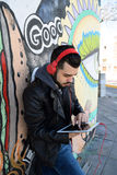 Young man using a tablet. Stock Photo