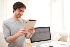 Young man using a tablet at the office Stock Photo