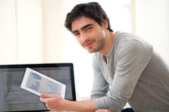 Young man using a tablet at the office Royalty Free Stock Images