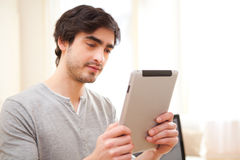 Young man using a tablet at the office Royalty Free Stock Photos
