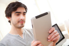 Young man using a tablet at the office Royalty Free Stock Photo