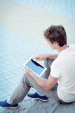 Young man is using a tablet Royalty Free Stock Photos