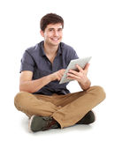 Young man using tablet pc Stock Photo