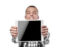 Young man using tablet pc Stock Photography