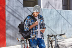 Young man using tablet pc touch in a bicycle Royalty Free Stock Image