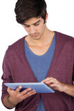 Young man using tablet pc Royalty Free Stock Photo
