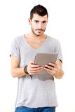 Young man using tablet Royalty Free Stock Photography