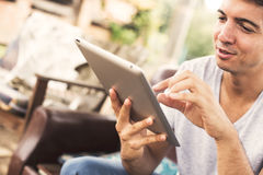 Young man using tablet Royalty Free Stock Image
