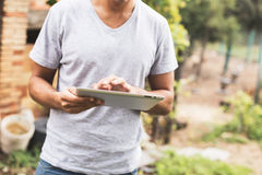 Young man using tablet Stock Photo