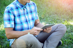 Young man is using tablet Royalty Free Stock Photos