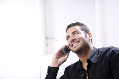 Young man using telephone Stock Photos