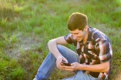 Young man using telephone Stock Photos