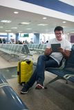 Young man using touch pad in the airport lounge Royalty Free Stock Image