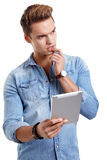 Young man using touchpad on white background Royalty Free Stock Photography