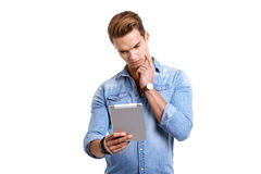 Young man using touchpad on white background Royalty Free Stock Photo