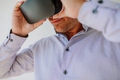 Young man using Virtual Reality glasses Royalty Free Stock Image