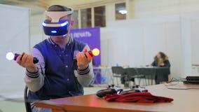 Young man using virtual reality glasses Royalty Free Stock Photo