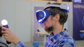 Young man using virtual reality glasses. VR stock video