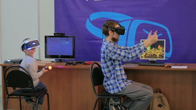 Young man using virtual reality glasses. VR Stock Images