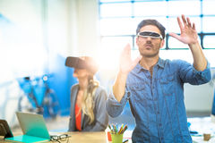 Young man using the virtual reality video glass Stock Images