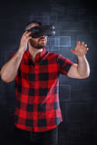 Young man using VR glasses. Headset trying to touch objects in virtual reality Royalty Free Stock Photos