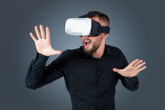 Young man using a VR headset glasses Stock Photography