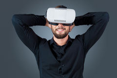 Young man using a VR headset glasses Royalty Free Stock Photo