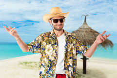 Young man on vacation. A young, attractive male in a colorful outfit in a tropical island setting as a stereotype tourist stock image
