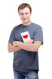 Young man with valentine's card in hands Stock Image